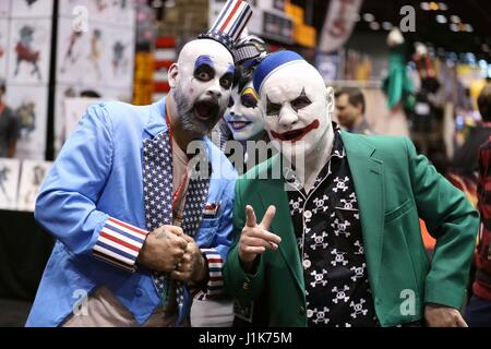 Chicago, USA. 21st Apr, 2017. Three cosplayers dressed in costume pose for pictures during the Chicago Comic and - Stock Photo