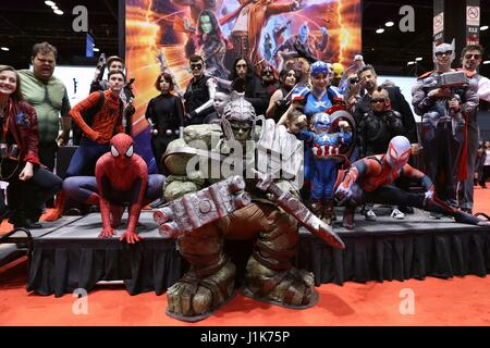 Chicago, USA. 21st Apr, 2017. A group of cosplayers dressed in costume pose for pictures during the Chicago Comic - Stock Photo