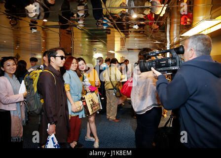 Athens, Greece's largest port. 21st Apr, 2017. Chinese Tourists board a Celestyal Cruises ship in Piraeus, Greece's - Stock Photo