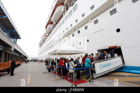 Athens, Greece. 21st Apr, 2017. Tourists board a Celestyal Cruises ship in Piraeus, Greece's largest port, Greece, - Stock Photo