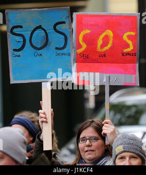 Rostock, Germany. 22nd Apr, 2017. 'SOS - Save our sciences' can be read on signs durin the 'March for Science' in - Stock Photo