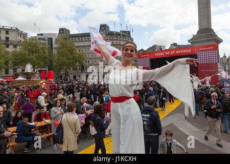 Trafalgar Square, London UK. 22 April, 2017. Feast of St. George.  Hundreds of red and white revellers celebrate - Stock Photo