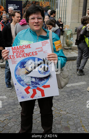 Paris, France. 22nd Apr, 2017. An activists caries the poster for the March for science. A few hundred people participated - Stock Photo