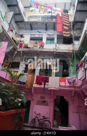 traditional clothing hanging out to dry in Varanasi, India - Stock Photo