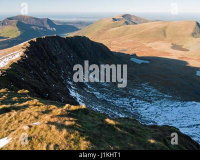 On Snowdon's Rhyd-Ddu path with a view across the cliffs of Llechog to Mynydd Mawr, Cwm Clogwyn and Moel Eilio - Stock Photo
