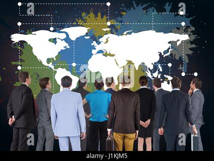 Digital composite of Business people in group looking at Colorful Map with paint splatters on wall background - Stock Photo