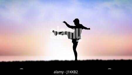 Digital composite of Silhouette of man exercising against sky during sunset - Stock Photo
