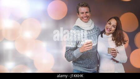 Digital composite of Happy couple holding disposable cups over bokeh - Stock Photo