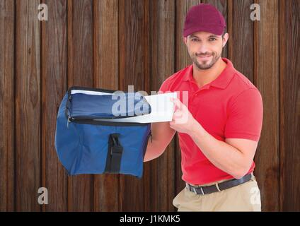 Digital composite of Pizza deliveryman with the delivery bag and pizza boxes. Wood background - Stock Photo