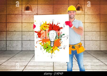 Digital composite of Carpenter holding billboard with painting while standing against wall - Stock Photo