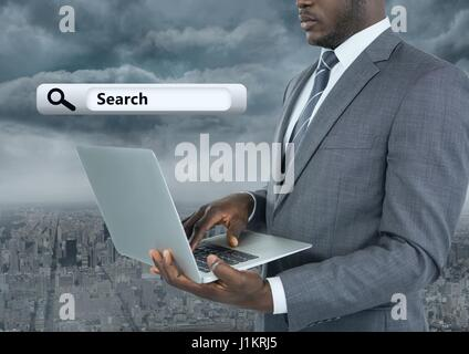 Digital composite of Businessman holding laptop with Search Bar with city background - Stock Photo