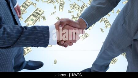 Digital composite of Midsection of business people shaking hands with money in background - Stock Photo
