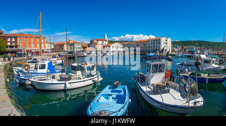 Izola, Slovenia, April 17, 2017: 44MP large panorama of Izola old fishing harbor with traditional fishing boats - Stock Photo