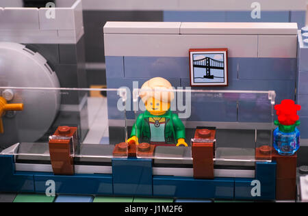 Tambov, Russian Federation - January 08, 2017 Lego bank manager on his working place with security glass in Brick - Stock Photo