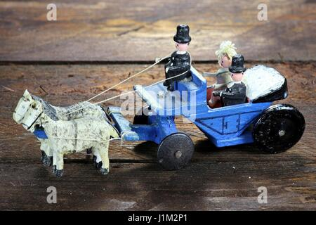 horse-drawn wedding coach from the Ore Mountains/ Germany on wooden background - Stock Photo
