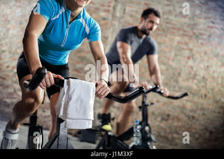 Sporty people doing training on bicycle - Stock Photo