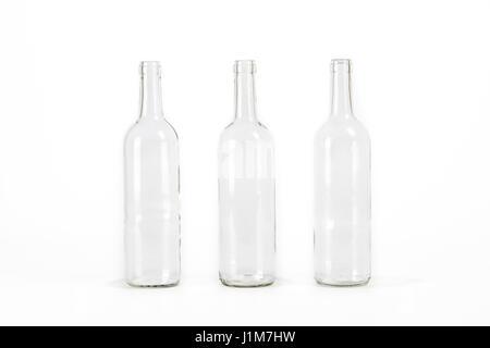 Three empty glass bottle isolated on white background - Stock Photo