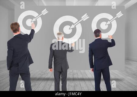Digital composite of Digital composite image of business people drawing arrow with target symbol - Stock Photo