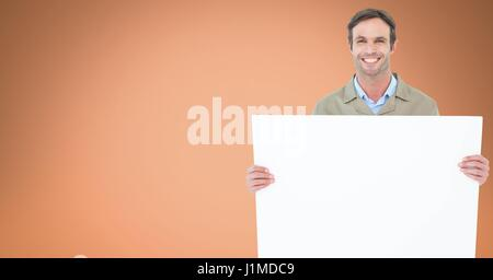 Digital composite of Portrait of man holding blank billboard against orange background - Stock Photo
