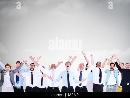 Digital composite of Business people celebrating success under grey sky - Stock Photo