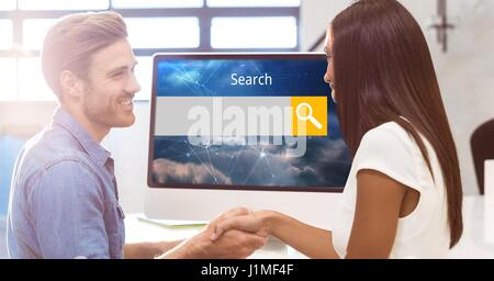 Digital composite of Smiling man and woman shaking hands with search screen on monitor - Stock Photo