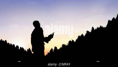 Digital composite of Silhouette businessman by mountains against sky - Stock Photo