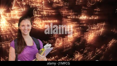 Digital composite of Digitally generated image of woman with books looking at glowing mathematical equations - Stock Photo