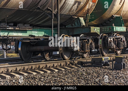 Two wheel sets of freight wagons of a train - Stock Photo