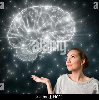 Young girl thinking with glowing brain illustration - Stock Photo