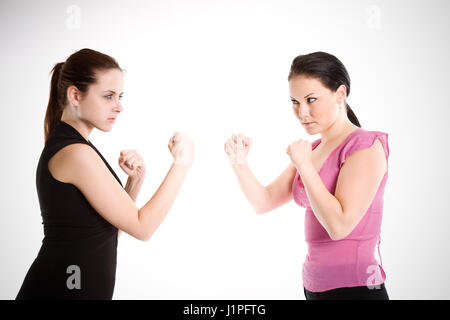 A shot of two businesswomen ready to fight - Stock Photo