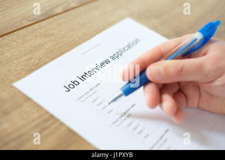 Man answering to the job resume application for employment - Stock Photo