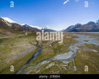 Wide river bed of the Tasman River, at back Mount Cook, Canterbury Region, Southland, New Zealand - Stock Photo