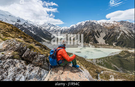View of Mount Cook and Hooker Valley, hiker looking into valley, Mount Cook National Park, Southern Alps, Canterbury - Stock Photo