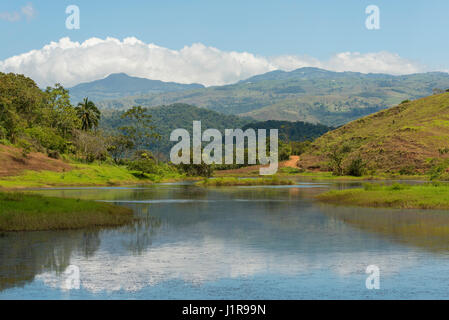 Lake in front of mountain landscape, near San Luis de Grecia, Alajuela province, Costa Rica - Stock Photo