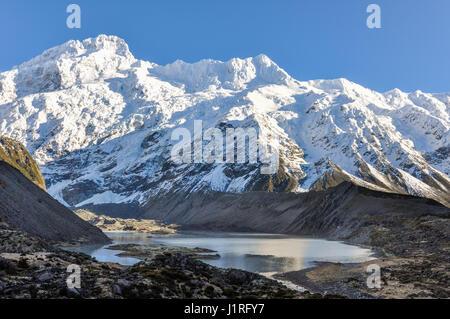 Snowy peak in the Aoraki/Mount Cook National Park, New Zealand - Stock Photo