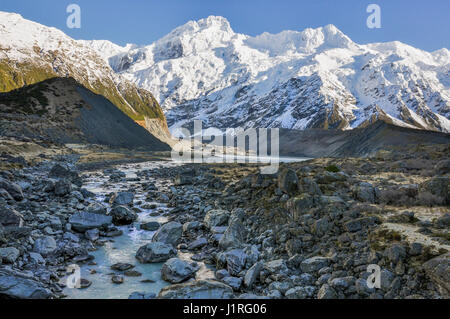 Hooker River and snowy mountains in the Aoraki/Mount Cook National Park, New Zealand - Stock Photo