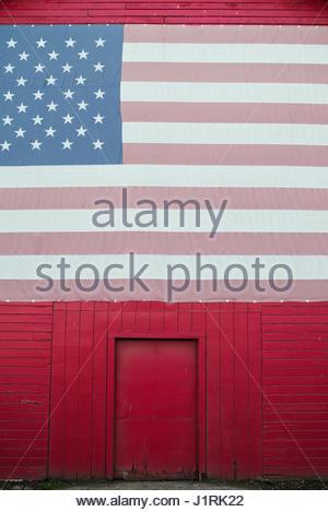 Red Barn With U.S. Flag, Gilroy, California - Stock Photo