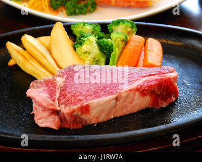 Fresh raw beef with fried potatoes and cauliflower - Stock Photo