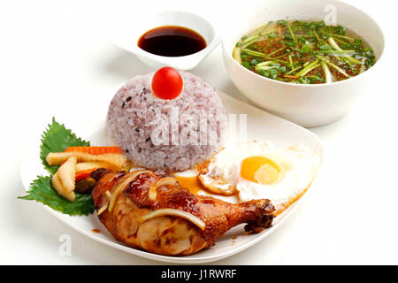 Vietnamese lunch set of rice with fried chicken legs - Stock Photo