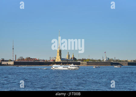 ST.PETERSBURG, RUSSIA - MAY 05, 2016:  Pleasure boat floats on the Neva river on the background of the fortress - Stock Photo