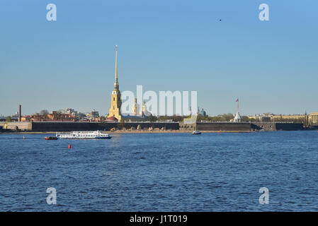 Pleasure boat floats on the Neva river on the background of the fortress clear day in summer in Saint-Petersburg - Stock Photo