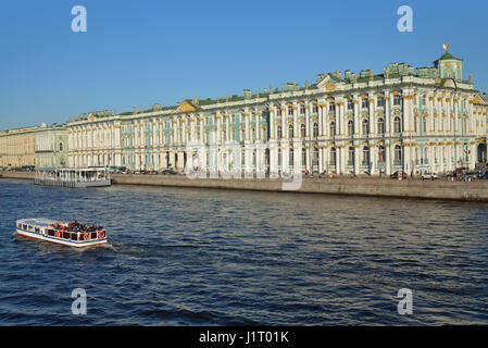 ST.PETERSBURG, RUSSIA - MAY 05, 2016:  A pleasure boat with tourists floats on the Neva river on the background - Stock Photo