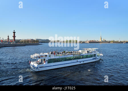 ST.PETERSBURG, RUSSIA - MAY 05, 2016:  Pleasure boat floats on the Neva river on the background of the Rostral columns - Stock Photo