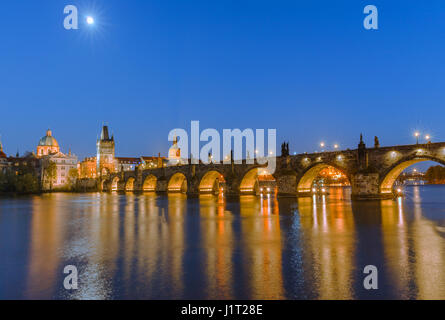 The famous Charles Bridge at sunset in Prague in the Czech Republic - Stock Photo