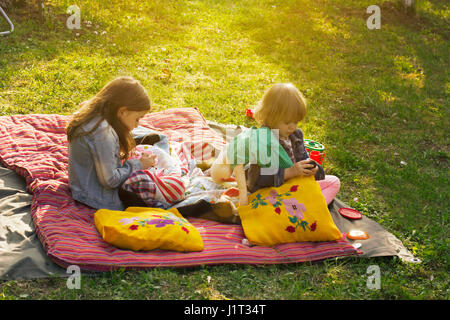 Two little girls having pillow fight on bed Stock Photo ...