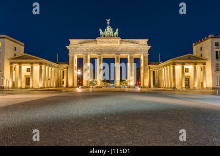 The famous Brandenburg Gate in Berlin illuminated at darkness - Stock Photo