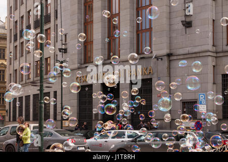 PRAGUE, CZECH REPUBLIC - APRIL 21, 2017: The building of the Czech National Bank, with colorful bubbles floating - Stock Photo