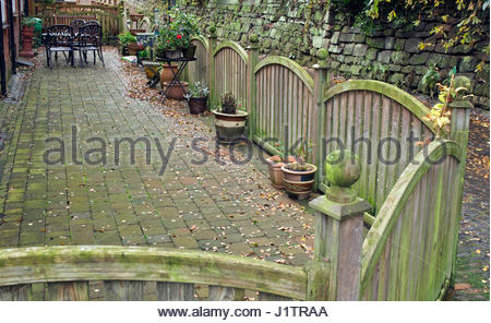STYLISH FENCE AROUND PATIO AREA WITH CONTAINERS   Stock Photo
