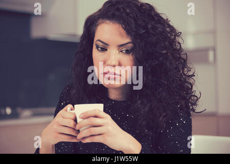 Beautiful young woman looking depressed - Stock Photo