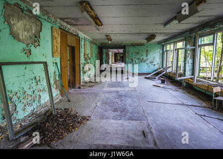 High school No 2 in Pripyat ghost city of Chernobyl Nuclear Power Plant Zone of Alienation around nuclear reactor - Stock Photo